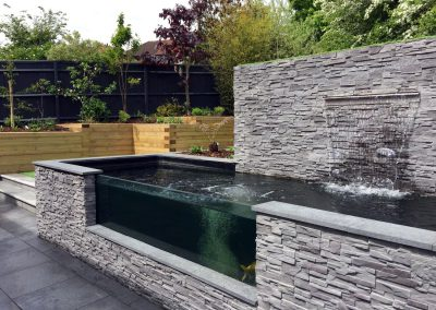 Modern Sloping Garden with Feature Koi Pond
