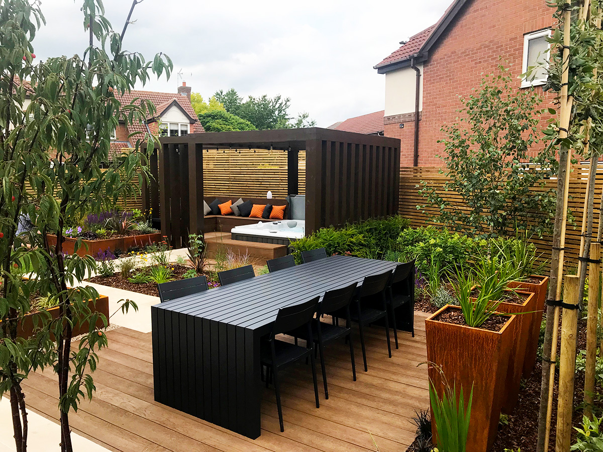Raised planters form a stylish edge to the patio area
